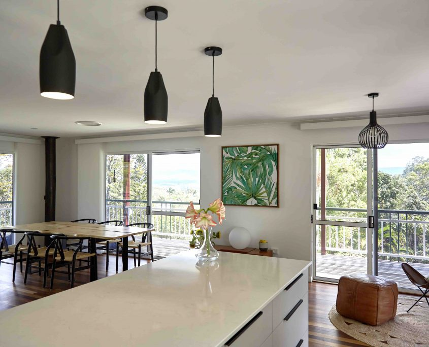 Timber Dining Table, Palm fond Art and wishbone chairs in Maroochy River Home Sunshine Coast