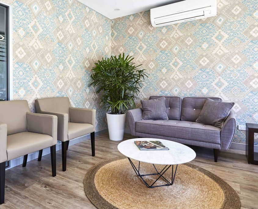 Indoor plants and feature wallpaper in waiting room furniture sourcing
