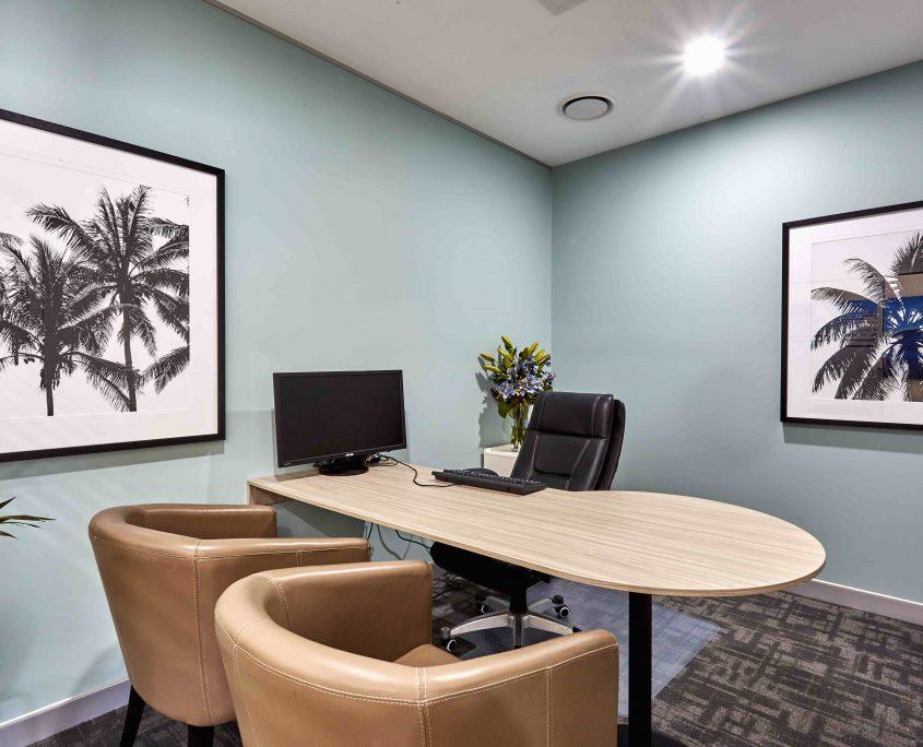 Tan leather chairs office space art sunshine coast