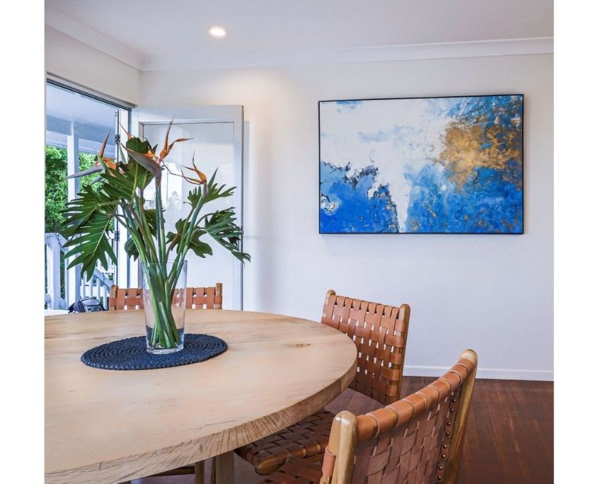 Dining table and blue artwork