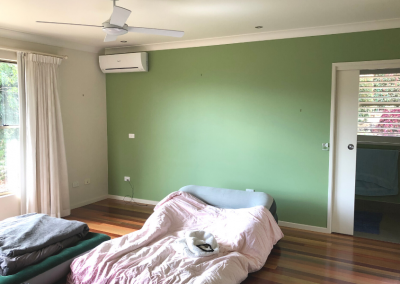 Bright green wall master bedroom before image