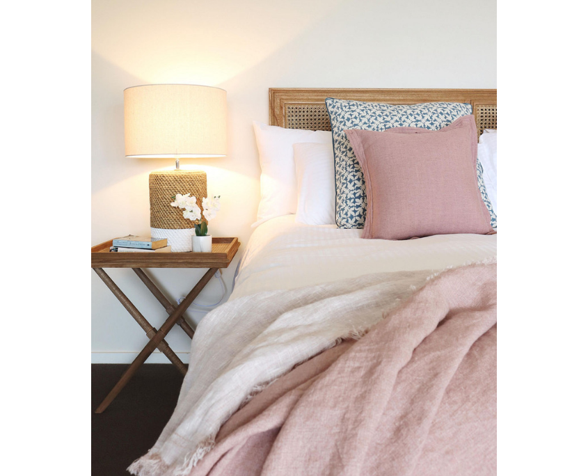 Pink Bed throw and rattan headboard
